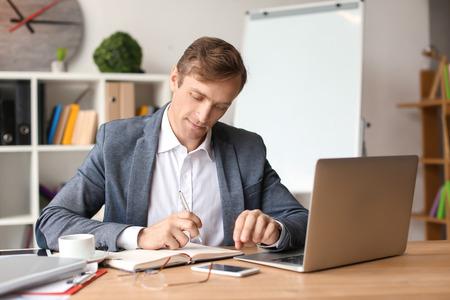 Handsome businessman working in office