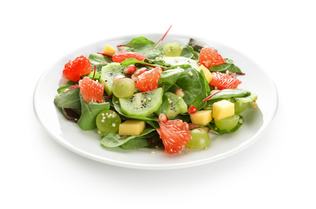 Plate with healthy fresh salad on white background