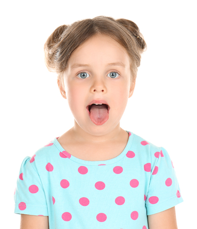 Cute little girl showing tongue on white background