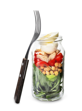 Delicious vegetable salad with egg in mason jar on white background