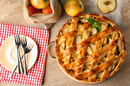 Delicious apple pie on table