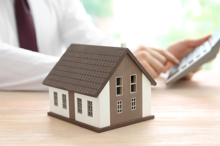House model on table of real estate agent