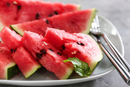 Slices of ripe watermelon on plate, closeup