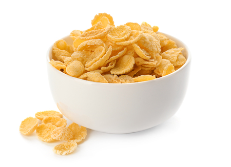 Bowl with healthy cornflakes on white background