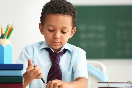 African-American boy doing exercise in classroom Standard-Bild