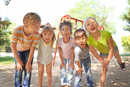 Portrait of funny little children outdoors