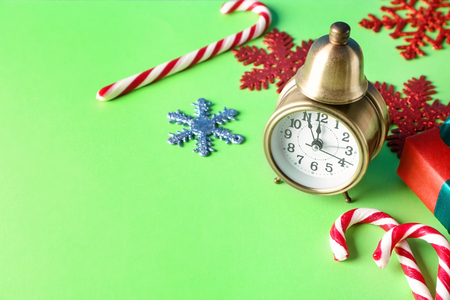 Alarm clock with decorations on color background. Christmas countdown