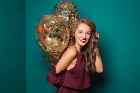 Beautiful young woman with balloons on color background Stok Fotoğraf
