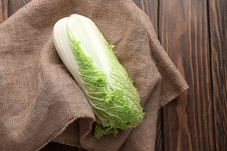 Fresh ripe cabbage on wooden table Stock Photo