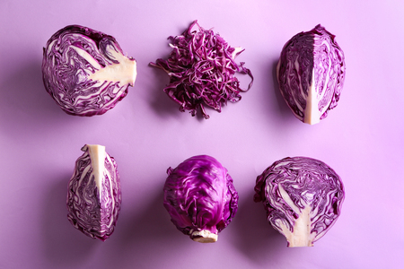 Cut red cabbage on color background
