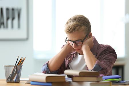 Teenager boy doing homework at home