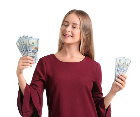 Happy young woman with dollar banknotes on white background Stock Photo