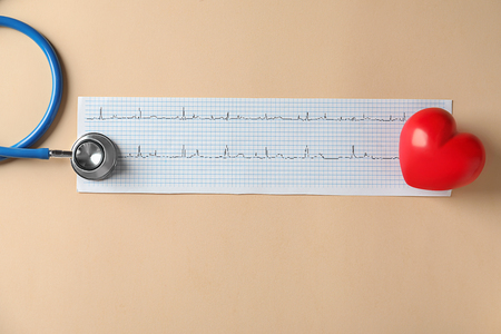 Medical stethoscope, red heart and cardiogram on light background Stok Fotoğraf