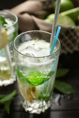 Glass of fresh mojito on wooden table