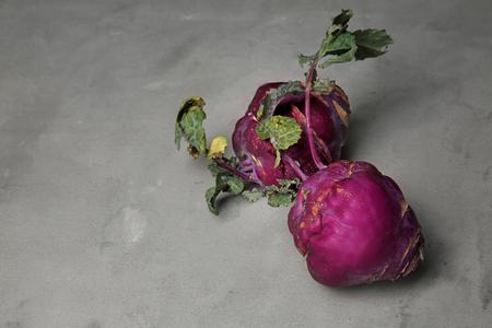Fresh kohlrabi on grey table