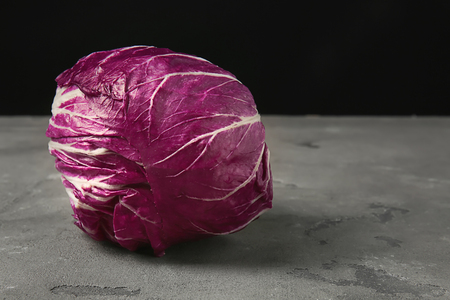 Ripe red cabbage on grey table Stockfoto