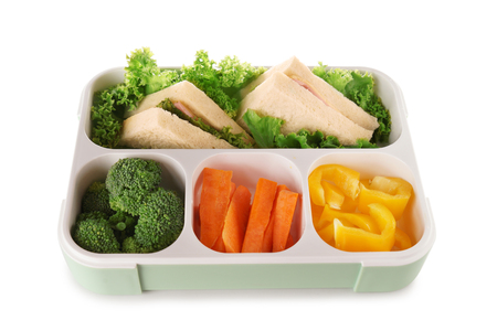 Food for schoolchild in lunch box on white background