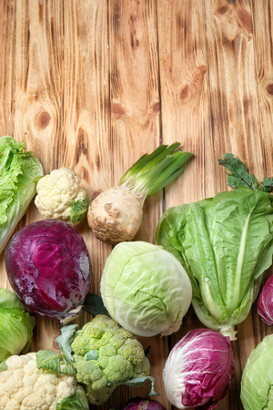Different types of cabbage on wooden background 스톡 콘텐츠