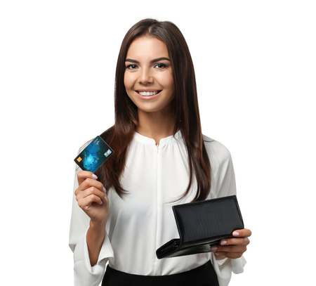 Young woman with credit card and purse on white background. Online shopping