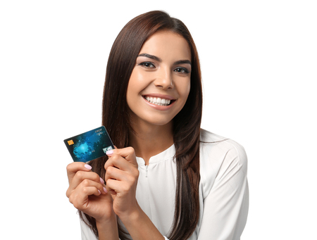 Young woman with credit card on white background. Online shopping 免版税图像