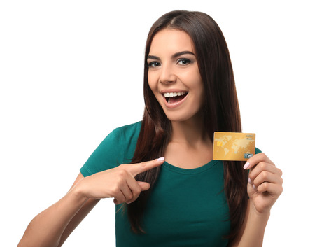 Young woman with credit card on white background. Online shopping Stockfoto