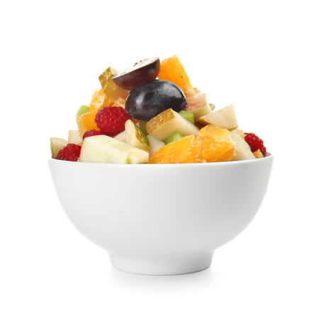 Delicious fruit salad in bowl on white background