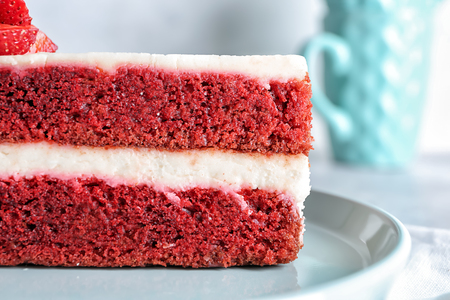 Piece of delicious strawberry cake on plate, closeup