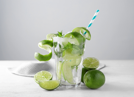 Glass of fresh mojito on light table Stock Photo
