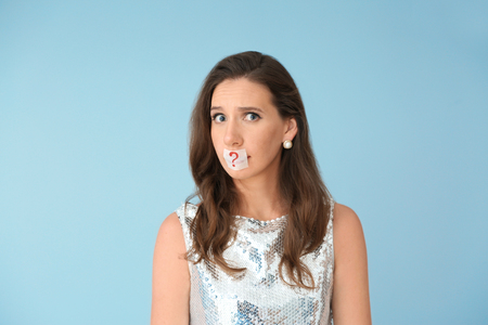 Emotional woman with taped mouth on color background. Diet concept Reklamní fotografie