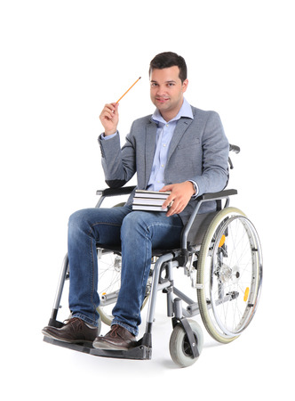 Male teacher in wheelchair with books on white background