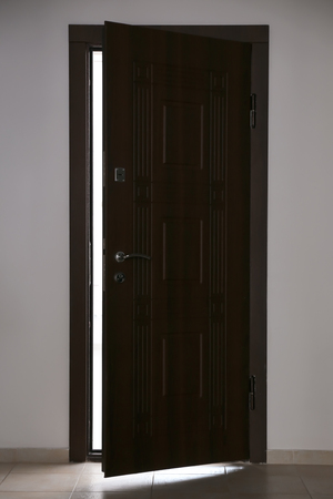 View of ajar wooden door