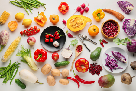 Different vegetables on white background, flat lay