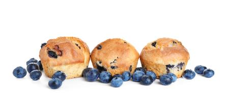 Tasty blueberry muffins on white background 免版税图像