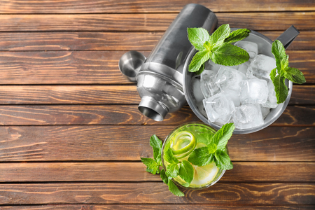 Composition with fresh mojito on wooden table