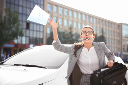 Emotional young businesswoman with documents in hurry to work 版權商用圖片 - 115059588
