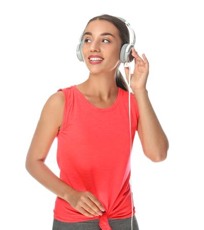 Beautiful young woman listening to music on white background Standard-Bild
