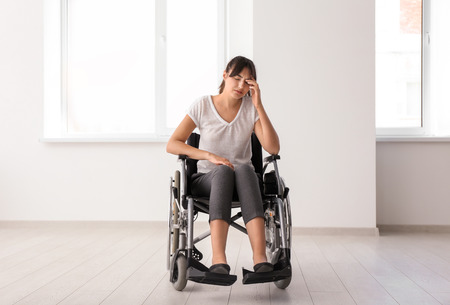 Depressed handicapped woman in empty room