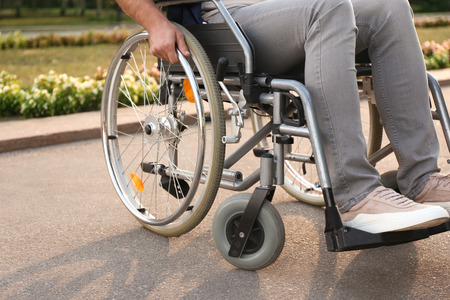 Young man in wheelchair outdoors