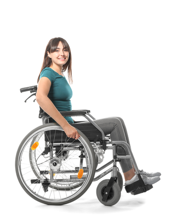 Happy young woman in wheelchair on white background Stock Photo