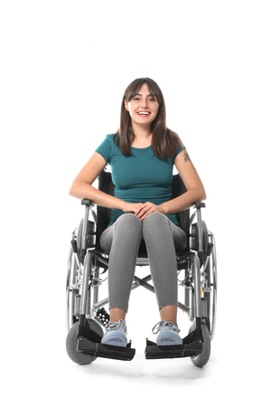 Happy young woman in wheelchair on white background Imagens