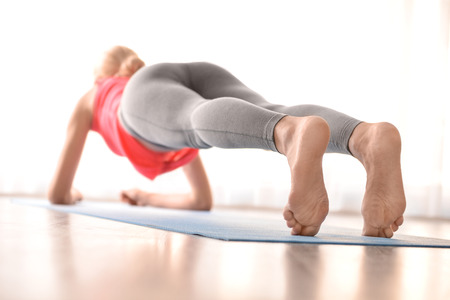 Young woman practicing yoga indoors Stock Photo