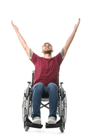 Happy young man in wheelchair on white background