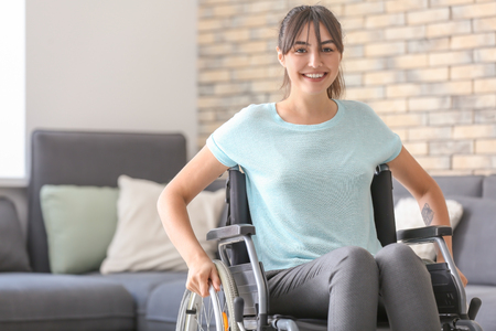 Young woman in wheelchair at home 写真素材
