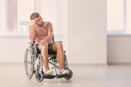 Depressed invalid man in empty room Imagens