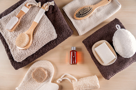 Composition with bathroom amenities on wooden background