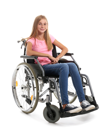 Teenage girl in wheelchair on white background 版權商用圖片