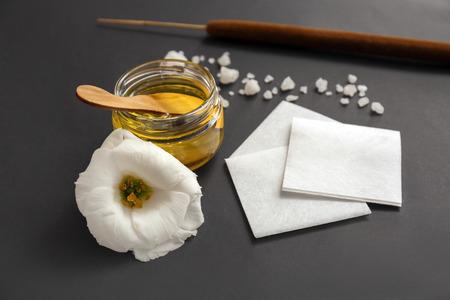 Jar with sugaring paste and strips on black background Zdjęcie Seryjne
