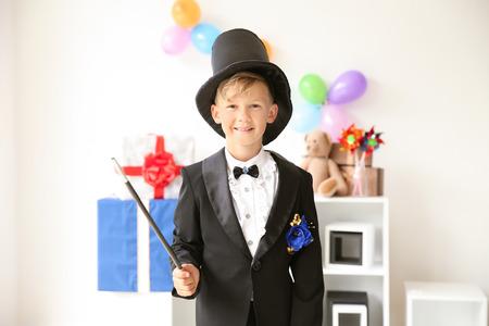 Cute little magician indoors Standard-Bild - 119755168