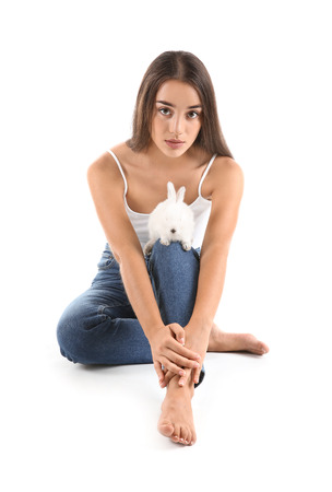 Beautiful young woman with cute bunny on white background 版權商用圖片