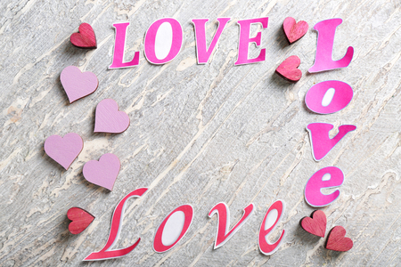 Words LOVE with color hearts on light background 스톡 콘텐츠